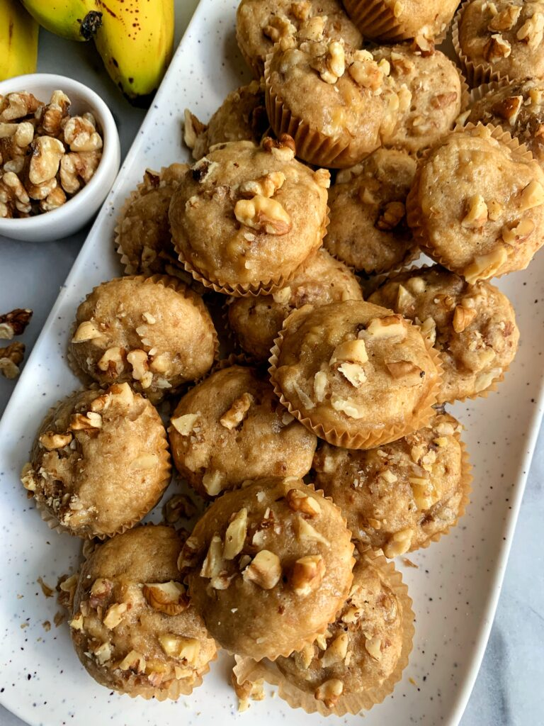 EPIC Gluten-free Mini Banana Walnut Muffins that remind me of those cutie Little Bites muffins I used to eat growing up. Except these are gluten-free, dairy-free and lower in sugar baby!