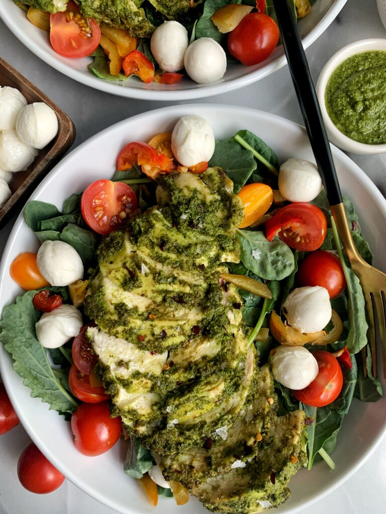This Pesto Chicken Caprese Salad is the ultimate salad to make everybody. It spices things up in your salad bowl, with your chicken game and the flavors with the tomatoes and mozzarella are out of this world!