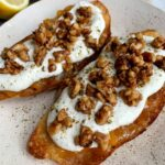 How to Make Epic Whipped Ricotta Toast topped with jam, candied walnuts and a little za'atar seasoning.