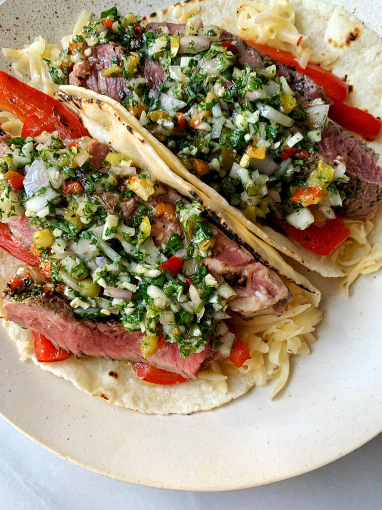 Epic Grill Pan Steak Tacos with Chimichurri Sauce! These are the ultimate steak tacos guys and you don't even need a grill to whip them up plus they're paleo and gluten-free.