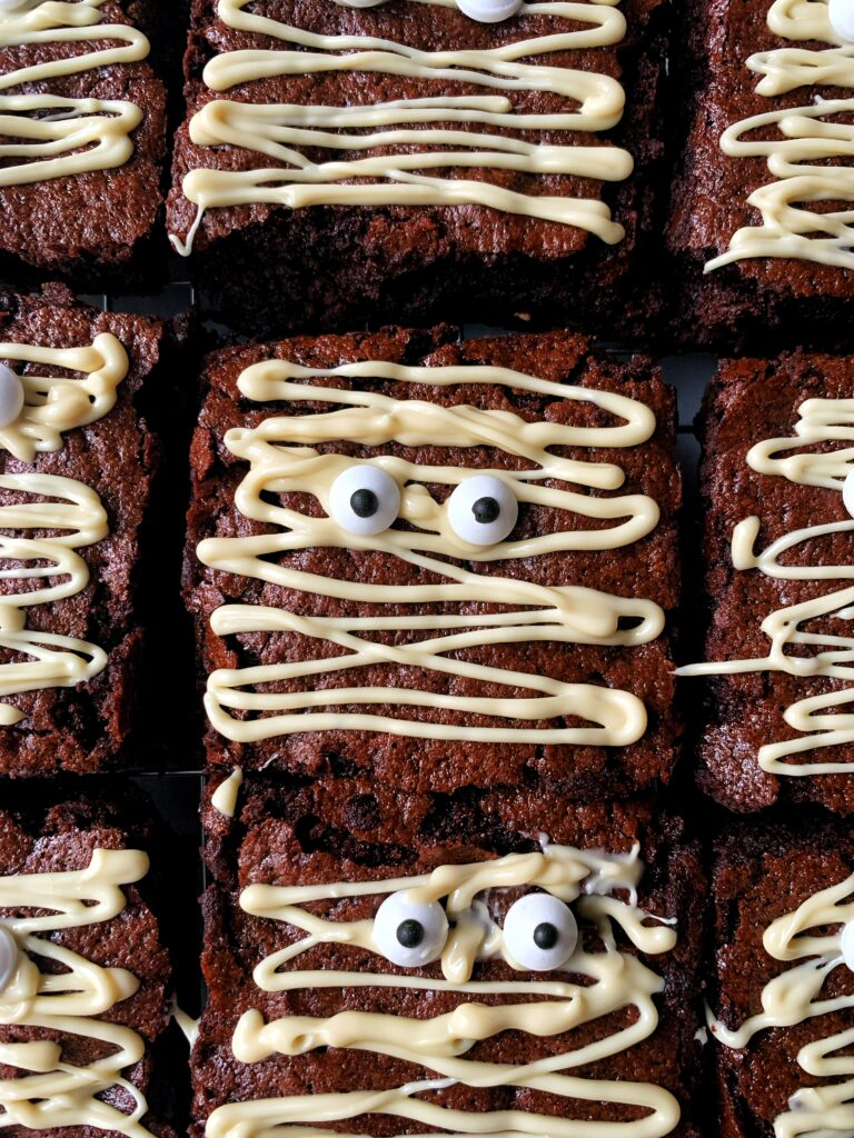 Delicious Halloween Mummy Brownies! These are the cutest brownie recipe to make for Halloween and they're kid-friendly and easy to make!